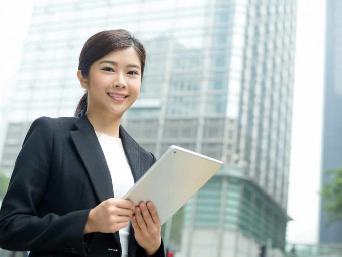 young business woman hold with tablet computer L75RAYG scaled